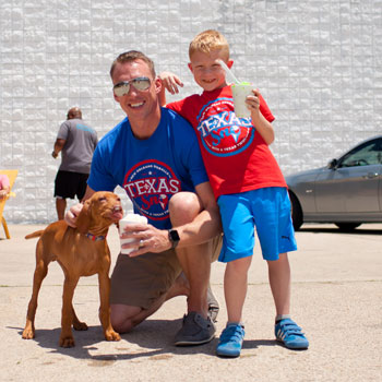 family with dog at Texas Sno